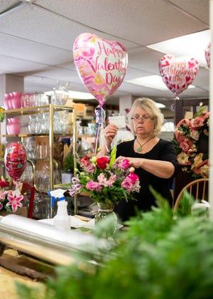 Sally Jablonsky, owner of the Herbert E. Berg Florist, creates Valentine's Day arrangements.