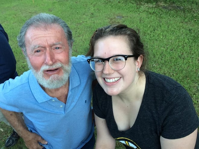 Joseph Craig and his granddaughter Caytlin Buckel share a moment in this photo taken in 2015 in Brimfield.