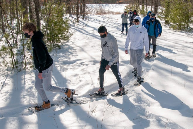 Students take a snow shoe hike during a physical education class at Shrewsbury High School on Thursday.