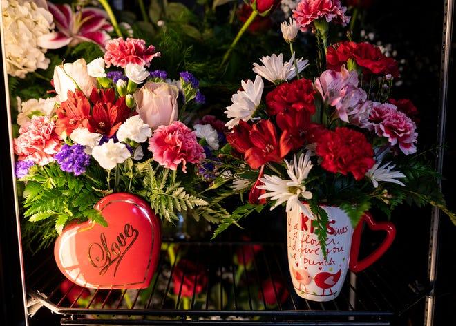 Valentine's Day arrangements on display at Herbert E. Berg Florist shop on Blackstone River Road in Worcester.