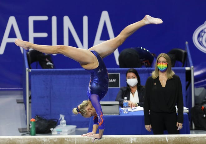 Florida gymnast Alyssa Baumann does her routine on the beam as head coach Jenny Rowland, right, watches during a meet against Missouri at Exactech Arena on Jan. 29.