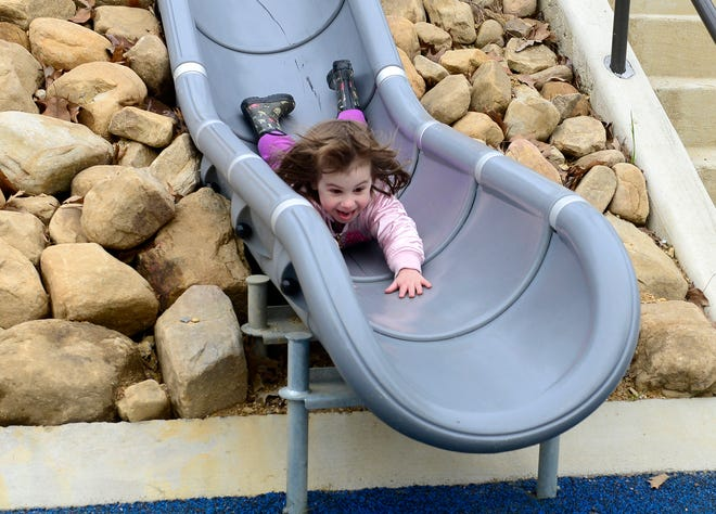Litha Cline, 3, takes a head-first slide at Moragne Park in Gadsden on March 16, 2019, as the park reopened following a $2.2 million renovation project. The park has been closed for nearly a year because of COVID-19 concerns, but city officials announced Wednesday it will reopen March 1.