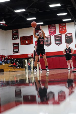 Tusky Valley's Arora Levengood laces a first half free throw as a part of her historic night.