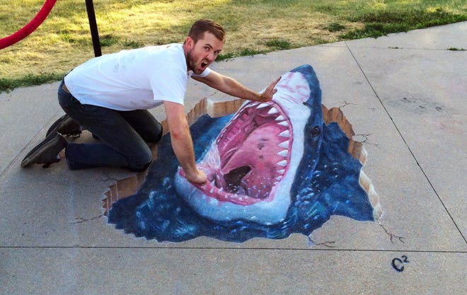 Chris Carlson poses with one of his sidewalk chalk creations that looks three-dimensional. He will be a guest artist for the FLLuxe Arts Festival on March 27.