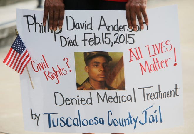 Family members of Phillip Anderson who allege he died as a result of mistreatment at the hands of the Tuscaloosa County Sheriff's department jailers, stand before the Federal Courthouse and speak to the media Wednesday June 1, 2016.  Staff Photo/Gary Cosby Jr.
