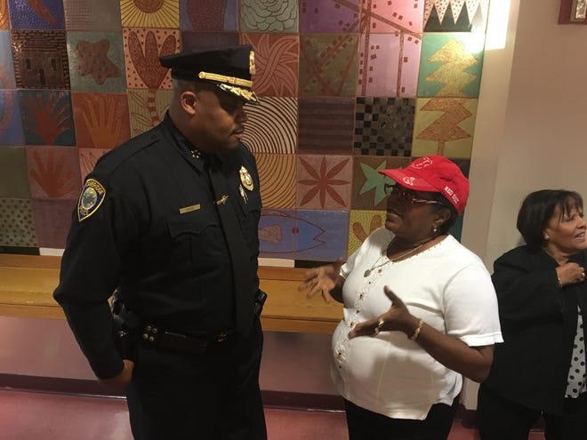 Cambridge Police Commissioner Dr. Branville Bard chats with a citizen.