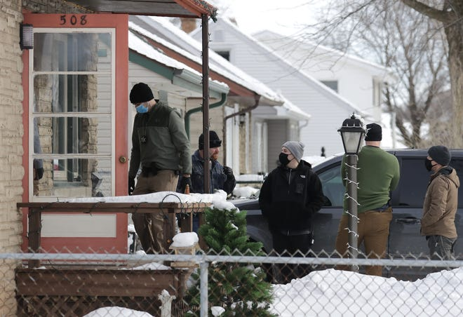 Appleton police serve a search warrant in the 500 block of E. Coolidge Avenue Thursday, February 11, 2021, in Appleton, Wis.