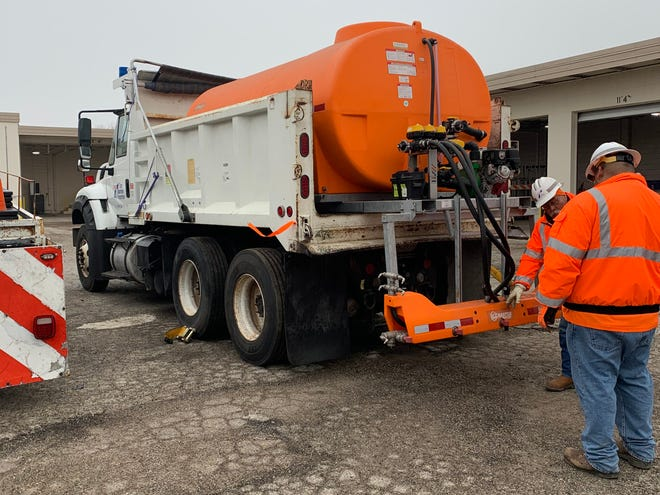 Personnel with TxDOT's Corpus Christi maintenance section prepare equipment Thursday that will be used to pretreat roadways in advance of anticipated winter weather.