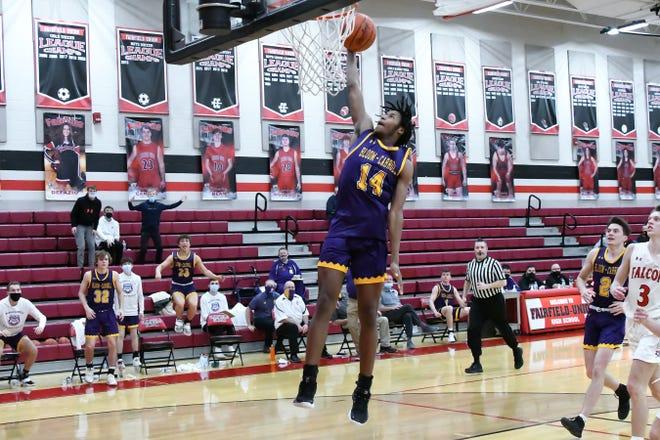 Bloom Carroll's Da'Shan Clark shoots a lay up against Fairfield Union Wednesday night at Fairfield Union High School. The Bulldogs won, 43-32. -Jamie Potts/Lancaster Eagle Gazette