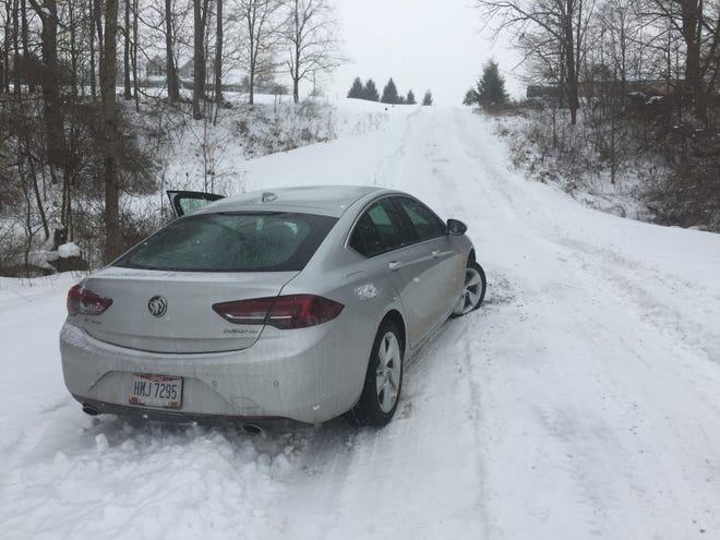 Reporter Mark Caudill found himself stuck in the snow on the way to a recent story and had to wait four hours for a tow truck.