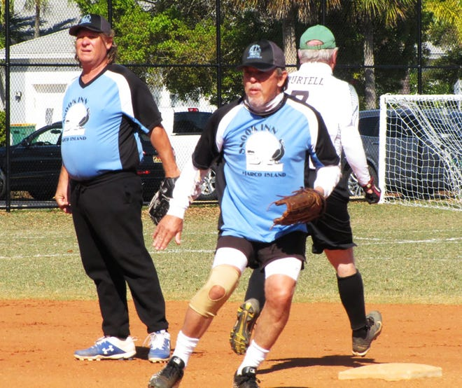 Snook Inn's Geoff Bentley completes a double play against Stonewalls with shortstop Chris Pickwell looking on.