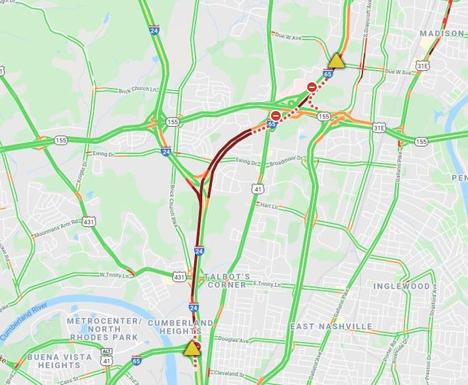 """A pair of rollover wrecks snarled traffic on Interstate 65 northbound and southbound during the morning commute in Nashville on Thursday. Northbound lanes remain fully closed after semi-truck driver and a dog died in a fiery wreck and a """"substantial"""" diesel spill was contained."""