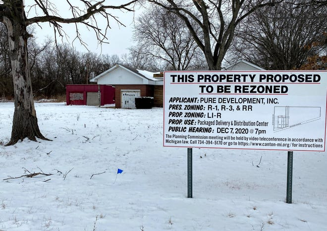 """A sign indicating the planned rezoning in front of a vacant residence along Michigan Avenue in Canton. A delivery station for a """"major online retailer"""" is planned at the site, though officials are declining to say which company is planning on locating there."""