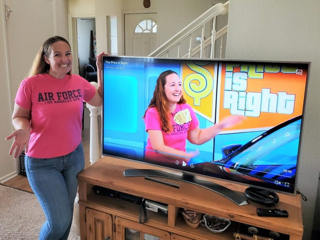 "Sheila Rupp watching herself win on ""The Price is Right."""
