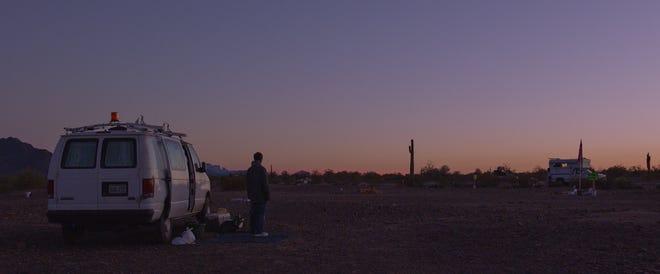 Frances McDormand stands in Quartzsite, Arizona, in a scene from 'Nomadland.'