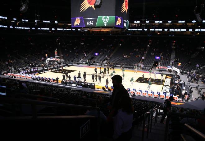 Feb 10, 2021; Phoenix, Arizona, USA; A fan finds his seat before NBA action between the Phoenix Suns and the Milwaukee Bucks at Phoenix Suns Arena. Mandatory Credit: Michael Chow-Arizona Republic