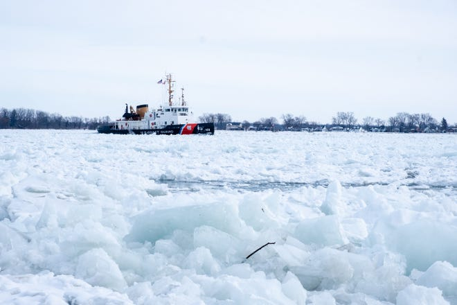 The USCGC Morro Bay breaks through ice on the St. Clair River Wednesday, Feb. 10, 2021, near a park in Marine City. The Morro Bay, along with several other U.S. Coast Guard cutters and Canadian Coast Guard ships, has been working to break up ice on the St. Clair River to relieve flooding.