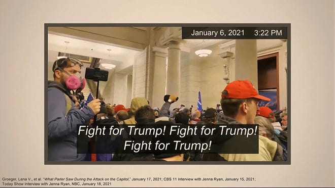 """This image from video shows one of many slides presented by Democrats prosecuting the impeachment of former President Donald Trump in the Senate at the U.S. Capitol in Washington, Wednesday, Feb. 10, 2021. The video, which showed Trump's supporters chanting """"Fight for Trump!"""" after they stormed into the U.S. Capitol on Jan. 6, was used by prosecutors as they sought to connect the mob with Trump and make the case that the president had incited them to insurrection. (Senate Television via AP)"""