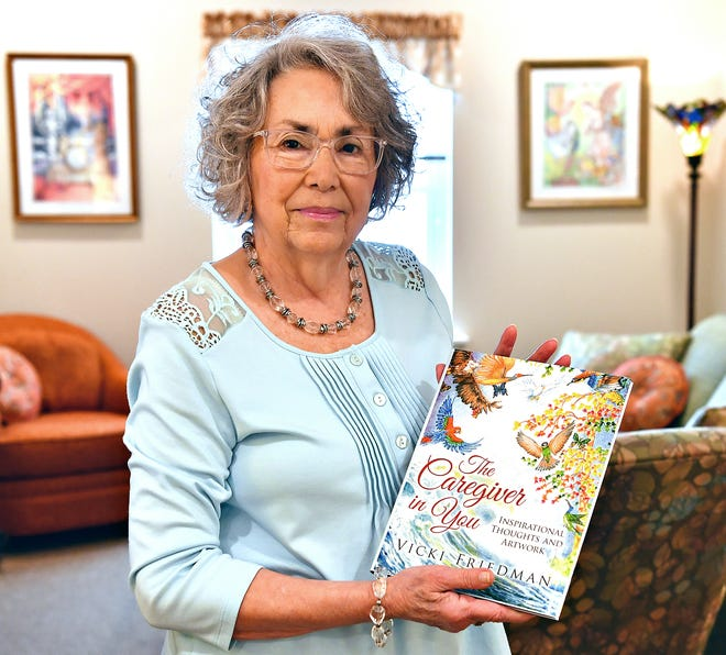 "Artist Vicki Friedman holds her first book, ""The Caregiver in You,"" in her home at Country Meadows Retirement Communities of Leader Heights in York Township, Thursday, Feb. 11, 2021. Friedman's has also illustrated 11 books and says her second book, ""Chirp Cheep Tweet with Owen Owl,"" a children's book about diversity, is currently in the hands of her publisher. Dawn J. Sagert photo"