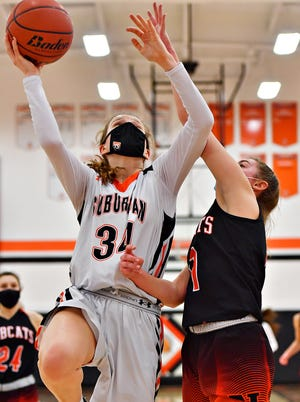 York Suburban's Maddison Perring takes the ball to the basket while Northeastern's Megan Elzinga defends during girls' basketball action at York Suburban High School in Spring Garden Township, Wednesday, Feb. 10, 2021. York Suburban would win the game 37-33. Dawn J. Sagert photo