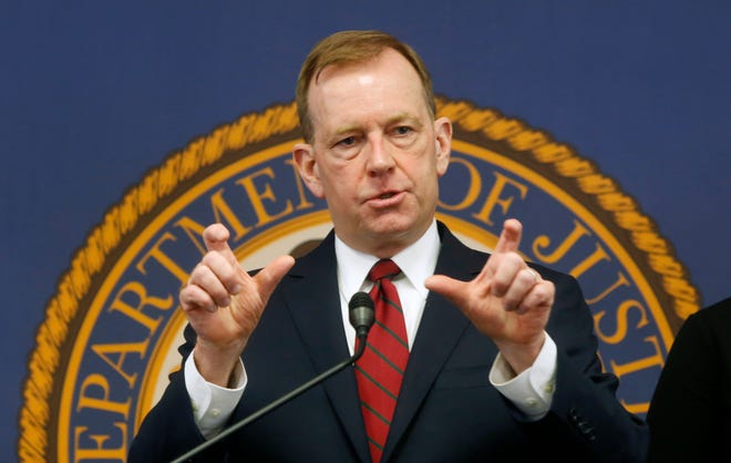 FILE - In this Jan. 24, 2020, file photo, McGregor Scott, the U.S. Attorney for the Eastern District of California, answers questions at a news conference in Sacramento Calif. U.S. Attorney Scott said on Monday, Nov. 30, 2020 that Samuel Keeton, 41, of Menifee, pleaded guilty to conspiracy to participate in a racketeering enterprise and to conspiracy to distribute heroin and methamphetamine. (AP Photo/Rich Pedroncelli, File)