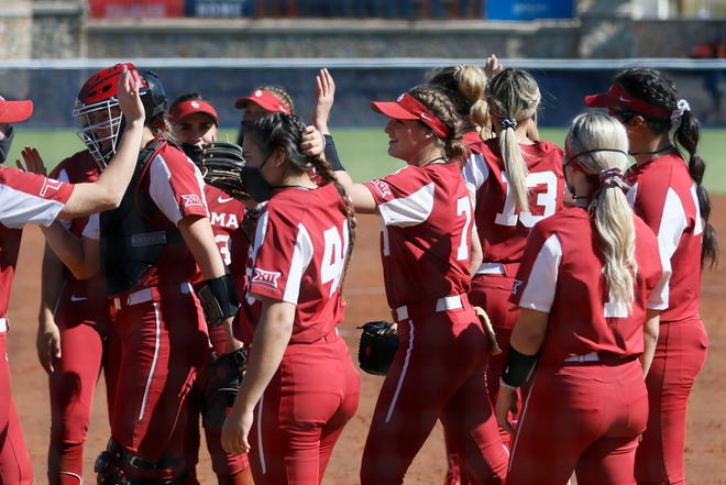 The Sooners celebrate after a win against UTEP on Feb. 11 at Helen of Troy Softball Complex in El Paso, Texas.