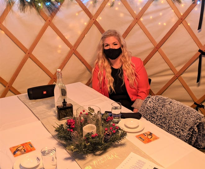 Shannon Foley, general manager of The Blue Fish in Breckenridge, sits in the comfy outdoor yurt, which comes with blankets and toe warmers for cold nights.