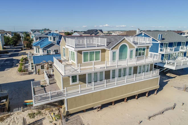 This oceanfront home on private North Indian Beach on the southern side of Dewey Beach is listed for $4,399,000.