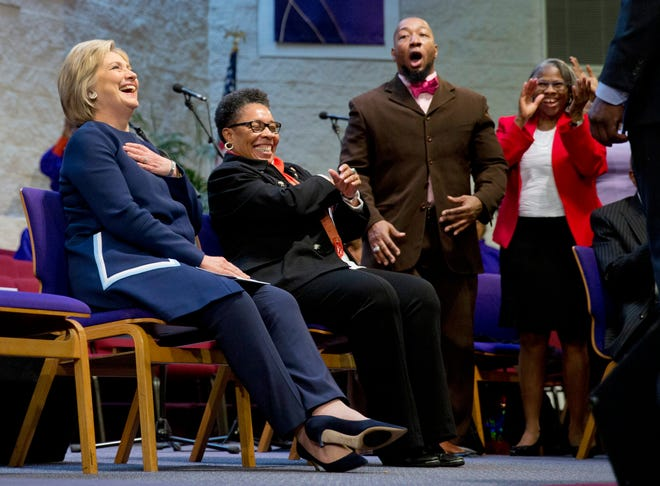 Democratic presidential candidate Hillary Clinton, left, sits with U.S. Rep. Marcia Fudge, D-Ohio, during service at Mount Zion Fellowship Church in Highland Hills, Ohio, Sunday, March 13, 2016.