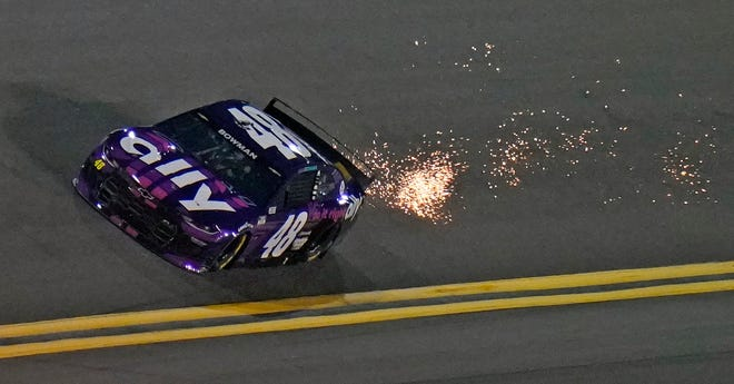 Alex Bowman kicks up sparks as he runs during a Daytona 500 qualifying session at Daytona International Speedway. Bowman took the pole position for Sunday's race.
