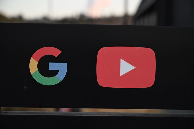 Google and YouTube logos are seen at the entrance to the Google offices in Los Angeles.