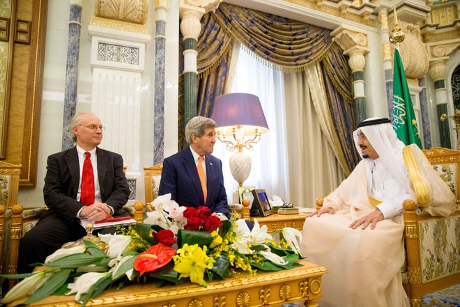 Secretary of State John Kerry, center, accompanied by Timothy Lenderking, US charge d'affaires, left, meet with Saudi Arabia's King Salman at the Royal Court, in Riyadh, Saudi Arabia, May 7, 2015.