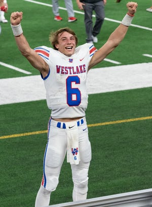 Quarterback Cade Klubnik celebrates after Westlake's 52-34 victory over Southlake Carroll in the Class 6A Division I championship game Jan. 16 in Arlington. The win capped a 14-0 season and gave the Chaps their first championship in the state's largest division.