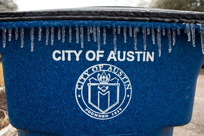Icicles form on a recycling bin in North Austin on Feb. 12, 2021. Icy weather is expected through Sunday.
