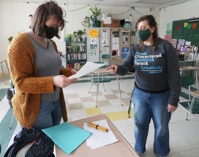 Sophomore Allison Whitacre, 15, looks at a form with English teacher Brittany Charek on Friday at Cloverleaf High School in Lodi. Charek leads a club activity at the school in creative writing. The students are competing virtually in a creative writing competition.