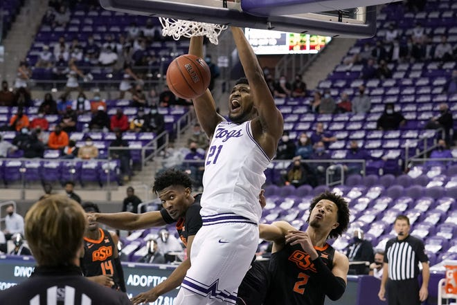 TCU center Kevin Samuel dunks over Oklahoma State players during the second half of their game Feb. 3.