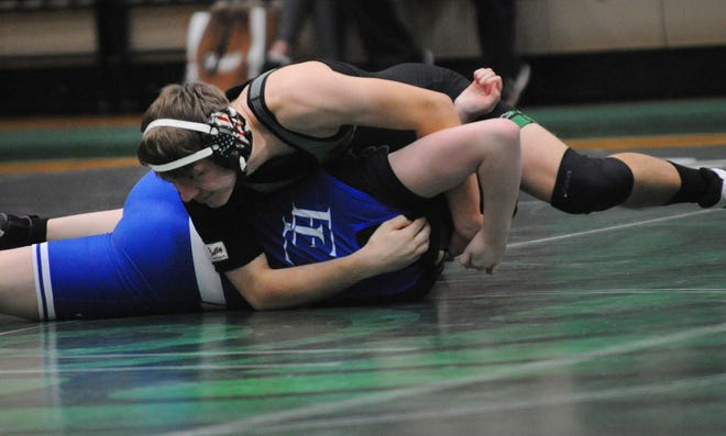 West Branch's Blake Schmidt wrestles East Liverpool's Payton Butler in a 152-pound match Thursday, February 11, 2021 at the West Branch Field House.