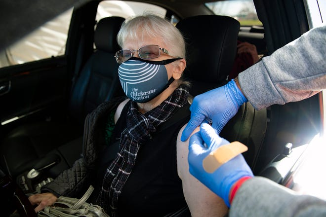 Roberta Woodruff, Regina Sale's daughter and caretaker, receiving her COVID-19 vaccination at the Ardmore Health Clinic on Friday, Jan. 15.