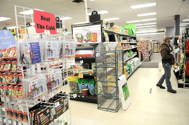 """Electric water pipe heating cables and window and patio door insulation kits are seen here on a rack with a sign reading """"Beat the Cold"""" at Farm & Home Hardware in Ashland as customers shop on Friday, Feb. 12, 2021. TOM E. PUSKAR/TIMES-GAZETTE.COM"""