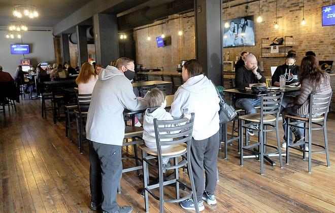 "Patrons enjoy lunch at Ohio Fire on East Main Street in Ashland on Friday. Owner Brad Bryan said lifting the restaurant/bar curfew in Ohio was a ""blessing."" TOM E. PUSKAR/TIMES-GAZETTE.COM"