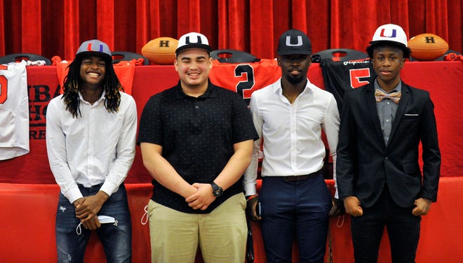 From left: Nicholas Bills, Raul Rodriguez, Marshall Chambers and Nigel Davis all signed their NLI's to play football at the Augusta United Graduate Academy, on Friday, Feb. 12, 2021 at Hephzibah High School. [WYNSTON WILCOX/THE AUGUSTA CHRONICLE]