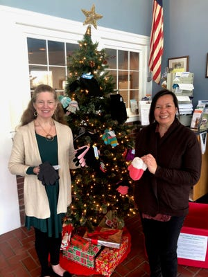 Pictured from left, Nancy Larkin-Taylor, a representative with Bucks for Kids, accepts the collection of winter outerwear items  donated by township residents from Michelle Clancy, a member of the New Britain Township Parks and Recreation Advisory Board.
