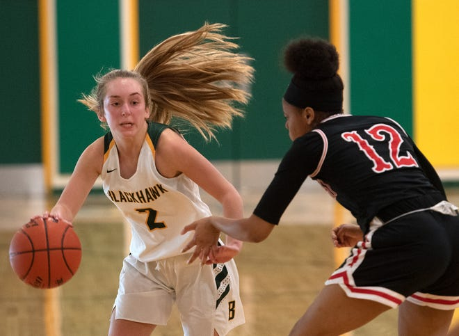 Blackhawk's Kassie Potts dribbles around New Castle's Deja Drew during Thursday night's game at Blackhawk High School.