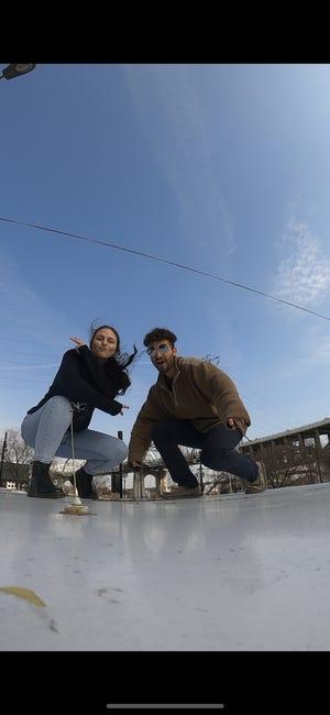 Danielle and Gunnar making a TikTok video atop their ambulance.
