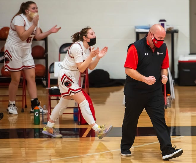 Sewickley Academy assistant coach Matt Walsh pumps his fists after the Panthers' win over OLSH Thursday at Sewickley Academy.