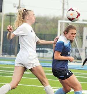 Bartlesville High defensive line standout Emma Sanderson, right, gets to the ball first during varsity girls soccer action in 2019.