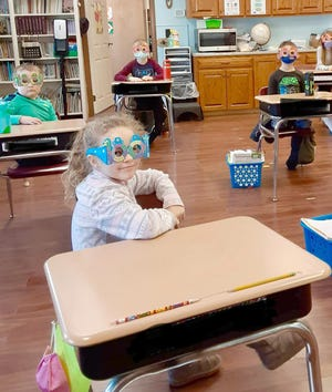 "Zion Lutheran School students Dixie Reinkemeyer (in front), Everett Terhune, Gentry Huth, and Collin Young, enjoyed wearing their ""100"" glasses to celebrate 100 days of school on January 29th."