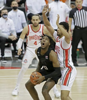 Michigan State Spartans forward Aaron Henry (0) is guarded by Ohio State Buckeyes forward Seth Towns (31) during Sunday's NCAA Division I Big Ten Conference men's basketball game at Value City Arena in Columbus, Ohio on January 31, 2021.