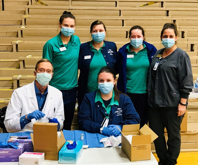 SRC nursing students recently assisted with a COVID-19 vaccination clinic. Pictured, front from the left, Graham Hospital pharmacist Matt Vogel and nursing student. Brook Massingale,  Pictured back are other nursing students who helped, too, Cassidy Long, Paige Harper, Taylor Sims, and SRC nursing educator Ashley Frederick