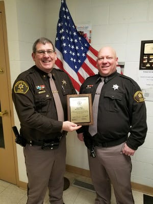 Fulton County Sheriff, Jeff Standard, is pictured with Deputy of the Year, Ryan Maricle.